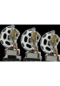 Trofeo figura fútbol con balón de fondo